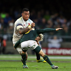 Faf de Klerk of South Africa looks to make a tackle on Nathan Hughes of England during the 2018 Castle Lager Incoming Series 3rd Test match between South Africa and England at Newlands Rugby Stadium,Cape Town,South Africa. 23,06,2018 Photo by (Steve Haag JMP)