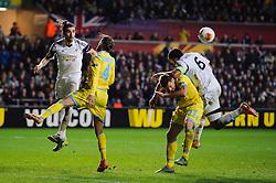 A corner ball skims past Swansea Defender Chico (ESP) and Defender Ashley Williams (WAL) - Photo mandatory by-line: Rogan Thomson/JMP - Tel: 07966 386802 - 20/02/2014 - SPORT - FOOTBALL - Liberty Stadium, Swansea -  Swansea City v SSC Napoli - UEFA Europa League, Round of 32, First Leg.