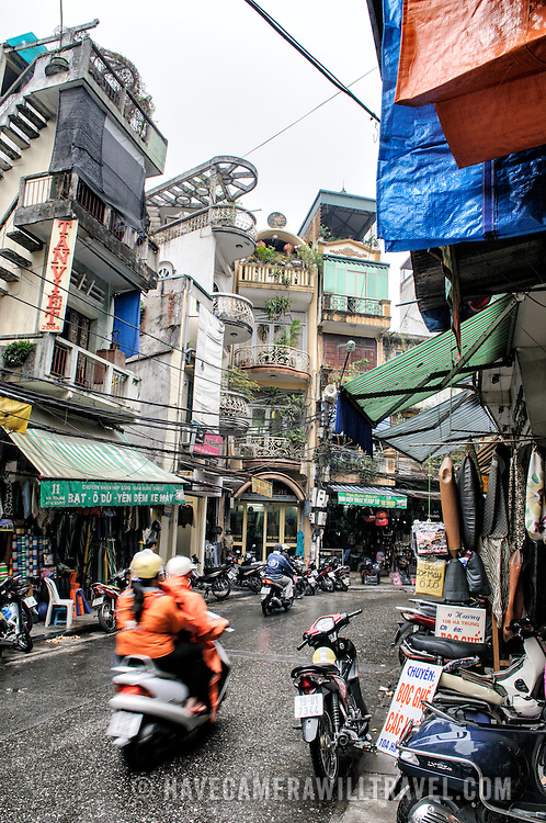 A street in a market district of Hanoi, Vietnam.