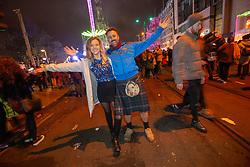 Emily Martin and Iain Goodfellow. Revelers in Princes Street. Hogmanay in Edinburgh.
