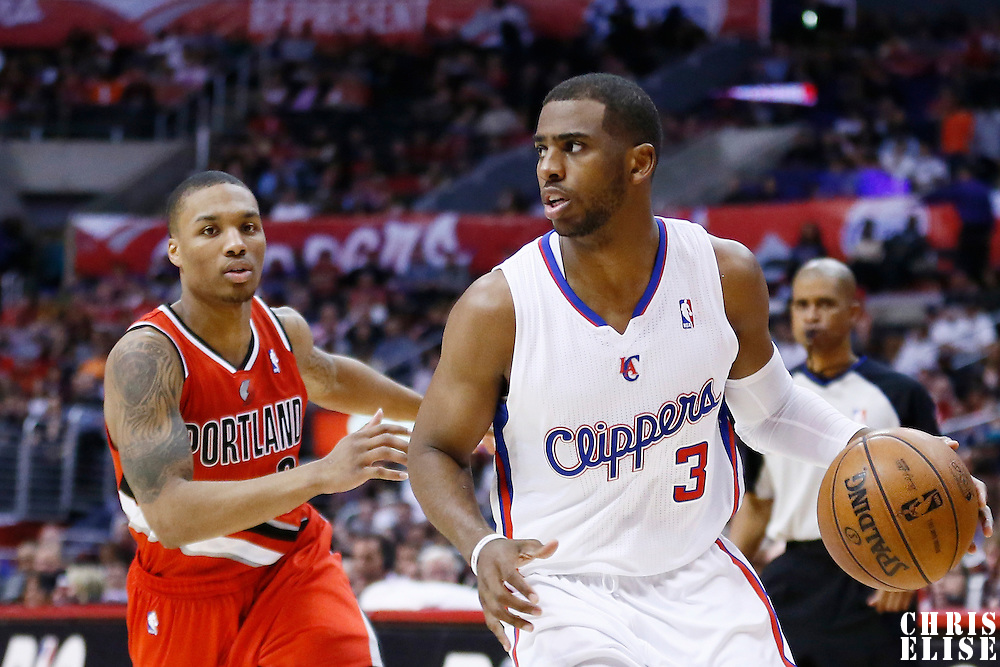 16 April 2013: Los Angeles Clippers point guard Chris Paul (3) drives past Portland Trail Blazers point guard Damian Lillard (0) during the Los Angeles Clippers 93-77 victory over the Portland Trail Blazers at the Staples Center, Los Angeles, California, USA.