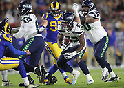 Seattle Seahawks running back Chris Carson (32) gains yards during an NFL football game against the Los Angeles Rams, Sunday, Dec. 8, 2019, in Los Angeles, Calif. The Rams defeated the Seahawks 28-12. (Peter Klein/Image of Sport)