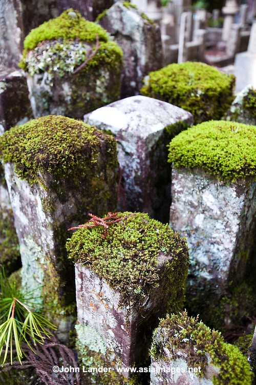 Moss Covered Gravestones at Okunoin - considered one of the most sacred places in Japan and is surrounded by Japan's largest graveyard. People from all over Japan, who wished to be buried close to Kobo Daishi, lie there, including former feudal lords, politicians and other prominent personalities. Their graves line the approaches to Okunoin for several hundred meters through the forest.