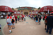 ANAHEIM, CA - JULY 20:  Fans enter the stadium in this general view photograph of the exterior facade of Angel Stadium before the Los Angeles Angels of Anaheim game against the Seattle Mariners at Angel Stadium on Sunday, July 20, 2014 in Anaheim, California. The Angels won the game 6-5. (Photo by Paul Spinelli/MLB Photos via Getty Images)