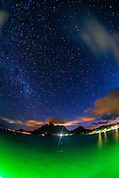 A starry sky and Mt. Otemanu and overwater bungalows at Four Seasons Resort Bora Bora, Bora Bora, Society Islands, French Polynesia.