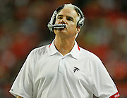 ATLANTA - AUGUST 29:  Head coach Mike Smith of the Atlanta Falcons looks at the scoreboard during the game against the San Diego Chargers at the Georgia Dome on August 29, 2009 in Atlanta, Georgia.  The Falcons beat the Chargers 27-24.  (Photo by Mike Zarrilli/Getty Images)