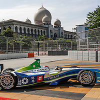 Italian Jarno Trulli of Trulli Formula E team speeds past the Palace of Justice building during the qualifying session of the FIA Formula E Championship racing series in Putrajaya, Malaysia, 22 November 2014. The second round of Formula E race takes place in Putrajaya on 22 November using cars powered only by electricity.