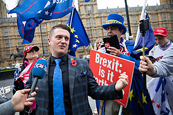 © Licensed to London News Pictures. 06/11/2018. London, UK. Stephen Yaxley-Lennon, also known as Tommy Robinson, seen in Westminster talking to pro-Trump supporters and anti-Brexit demonstrators. Photo credit : Tom Nicholson/LNP