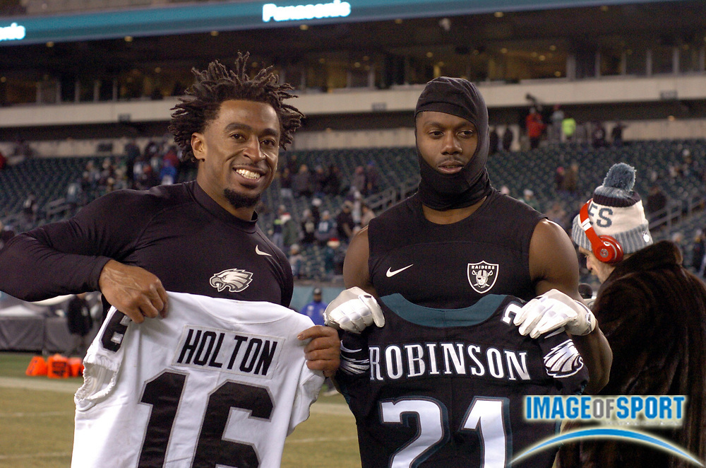 Dec 25, 2017; Philadelphia, PA, USA; Oakland Raiders wide receiver Johnny Holton (16) and Eagles cornerback Patrick Robinson (21) trade jerseys after a NFL football game at Lincoln Financial Field. The Eagles defeated the Raiders 19-10. Photo by Reuben Canales