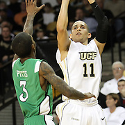 Central Florida guard Isaac Sosa (11) shoots over Marshall guard Damier Pitts (3) during a Conference USA NCAA basketball game between the Marshall Thundering Herd and the Central Florida Knights at the UCF Arena on January 5, 2011 in Orlando, Florida. Central Florida won the game 65-58 and extended their record to 14-0.  (AP Photo/Alex Menendez)