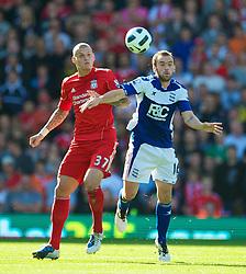 BIRMINGHAM, ENGLAND - Sunday, September 12, 2010: Liverpool's Martin Skrtel and Birmingham City's James McFadden during the Premiership match at St Andrews. (Photo by David Rawcliffe/Propaganda)