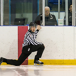 Oakville, ON - FEB 26 2016 - Ontario Junior Hockey League game action between Aurora Tigers and Oakville Blades at the Sixteen Mile Sports Complex Oakville, ON. Official does his pre-game stretches before puck drop. <br /> (Photo by Kevin Sousa / OJHL Images)