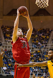 Mar 2, 2016; Morgantown, WV, USA; Texas Tech Red Raiders forward Matthew Temple (34) dunks the ball during the first half against the West Virginia Mountaineers at the WVU Coliseum. Mandatory Credit: Ben Queen-USA TODAY Sports