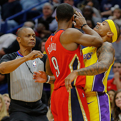 Feb 14, 2018; New Orleans, LA, USA; Los Angeles Lakers guard Isaiah Thomas (7) and New Orleans Pelicans guard Rajon Rondo (9) are called for a double technical during the first quarter at the Smoothie King Center. Mandatory Credit: Derick E. Hingle-USA TODAY Sports