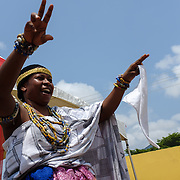 A traditional dancer at a swearing-in ceremony for newly elected members of a council of Queen Mothers in Accra, Ghana on 23 June 2015. A queen mother is a traditional female leader, drawn from the relevant chiefly lineage, who is responsible for women's and children's issues in particular. Though often widely respected and sometimes powerful, especially in matrilineal ethnic groups, their authority is subject to a male chief. After being suppressed during the colonial era, the role of queen mother is being revived in Ghana and is seen by many as a force for development.