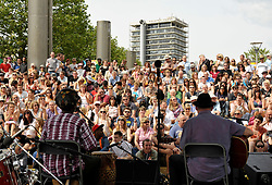 © Licensed to London News Pictures. 21/07/2012. Bristol, UK. Bristol Harbour Festival in Bristol docks.  Picture of crowds listening to music.  21 July 2012..Photo credit : Simon Chapman/LNP