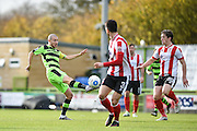 Forest Green Rovers Midfielder, Liam Noble (15) is first to the ball during the Vanarama National League match between Forest Green Rovers and Lincoln City at the New Lawn, Forest Green, United Kingdom on 19 November 2016. Photo by Adam Rivers.