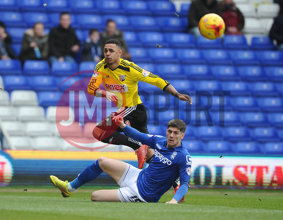 Brentford's Andre Gray sees his shot blocked by Birmingham City's Rob Kiernan  - Photo mandatory by-line: Joe Meredith/JMP - Mobile: 07966 386802 - 28/02/2015 - SPORT - Football - Birmingham - ST Andrews Stadium - Birmingham City v Brentford - Sky Bet Championship