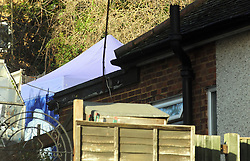 © Licensed to London News Pictures. 05/01/2016<br /> Police forensics officer in the backgarden searching.<br /> <br /> Sian Blake's home in Erith,Kent has turned into a crime scene today (05.01.2016) with officers from the Met's Homicide and Major Crime Command leading the search for the missing family.<br /> Police teams at the home of missing EX-EastEnders actress SIAN BLAKE who has been missing along with her Boyfriend and two sons since early December 2015.<br /> (Byline:Grant Falvey/LNP)