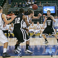 Viking guard Sam Muzik (20) gets a pass from fellow guard Steven Garth (22)