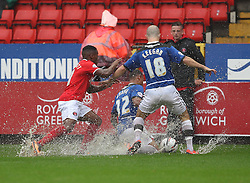 Doncaster Rovers' Luke McCullough & Paul Keegan fight for the ball in the wet with Charlton Athletic's Callum Harriott  - Photo mandatory by-line: Robin White/JMP - Tel: Mobile: 07966 386802 24/08/2013 - SPORT - FOOTBALL - The Valley - Charlton -  Charlton Athletic V Doncaster Rovers - Sky Bet League Two