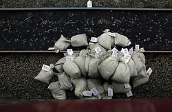 UK ENGLAND COTTAM 23SEP14 - Sacks of coal lie next to a railway line during a protest against coal shipments to the UK.<br /> <br /> Over fifty Greenpeace UK activists stopped a freight train carrying 1,500 tonnes of coal to Cottam power station in Nottinghamshire, England.<br /> <br /> jre/Photo by Jiri Rezac / Greenpeace<br /> <br /> © Jiri Rezac 2014