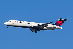 Delta Airlines Boeing 717-200 (registration N921AT) approaches San Francisco International Airport (SFO) over San Mateo, California, United States of America