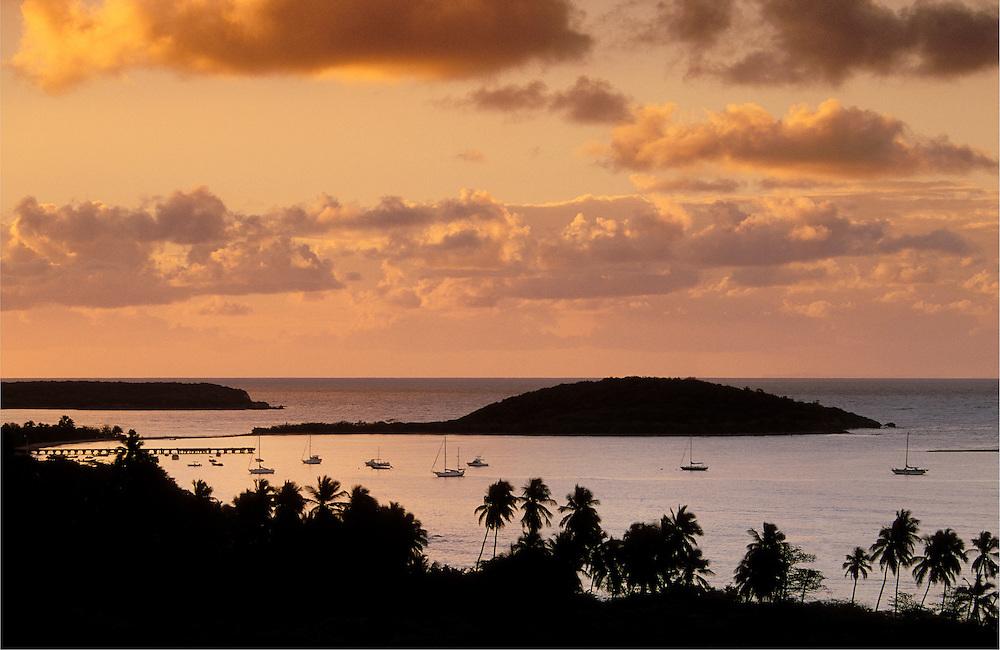 View of boats in bay at Esperanza and Cayo Tierra from Hacienda Tamarindo at sunrise; Vieques Island, Puerto Rico.