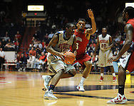 """Mississippi's LaDarius White (10) drives on Louisiana-Lafayette's Darnell Jackson (3) at C.M. """"Tad"""" Smith Coliseum in Oxford, Miss. on Wednesday, December 14, 2011. (AP Photo/Oxford Eagle, Bruce Newman)"""