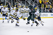 The University of Michigan Wolverines face-off against the Michigan State Spartans in the first night of a home-and-home matchup at the Red Berenson Rink at Yost Ice Arena in Ann Arbor on Thursday December 07, 2017. (Andrew Knapik/MiHockeyNow)