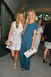 Left to right, sisters SIENNA MILLER and SAVANNAH MILLER at a summer drinks party hosted by Bec Astley Clarke at the Serpentine Sackler Gallery, Hyde Park, London on 17th June 2014.