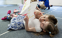 """Sophie Pankhurst and Olivia Lamper look over each others lines in the poem """"Sick"""" by Shel Silverstein before rehearsing during Wednesday mornings Winnipesaukee Playhouse Vacation Week Theater Camp session.  (Karen Bobotas/for the Laconia Daily Sun)"""