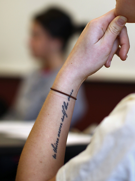 "3/7/11 4:31:58 PM -- Minneapolis, MN, U.S.A.---.Lauren Anderson, 21, of West Bloomfield, MI, participates in a weekly StepUP Leadership Team meeting with fellow students in substance abuse recovery at Augsburg College in downtown Minneapolis March 7, 2011.  Her tattoo reads, ""To thine own self be true."".---.Photo by Courtney Perry, Freelance."