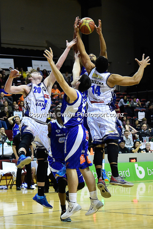 Finn Delany and Mika Vukona of the Giants jump for the ball with Jordan Ngatai and Dion Prewster of the Saints during a NBL - Saints vs Giants semi final four basketball match at the TSB Arena in Wellington on Friday the 4th of July 2014. Photo by Marty Melville/www.Photosport.co.nz