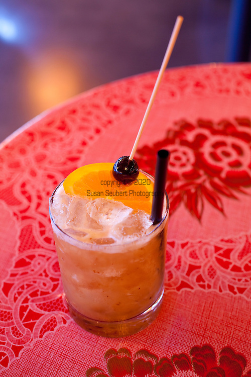 "The Whiskey Soda Lounge in Portland, Oregon's SE Neighborhood serves up aahaan kap klaem, the drinking food of Thailand, and the same drinks menu as its mother restaurant, Pok Pok. One of the lounge's signature drinks, ""Tamarind Whiskey Sour"" with tamarind, lime juice, palm sugar and bourbon served on the rocks."