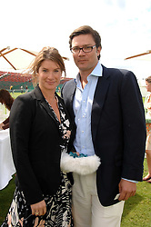 The HON.SELINA TOLLEMACHE and ANDREW WESSELS at the Cartier International polo at Guards Polo Club, Windsor Great Park on 29th July 2007.<br />