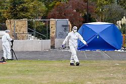 © Licensed to London News Pictures. 22/09/2019. SLOUGH, UK.  A forensics team at work next to a skate park near one of two forensics tents at Salt Hill Park in Slough, Berkshire, where it is reported a 15 year old boy was fatally stabbed after an altercation with another male.  Emergency services attended the scene at 6.30pm on the evening of 21 September where the boy was pronounced dead.  Investigations are ongoing.  Photo credit: Stephen Chung/LNP
