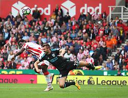Wilfried Bony of Stoke City (L) heads at goal - Mandatory by-line: Jack Phillips/JMP - 24/09/2016 - FOOTBALL - Bet365 Stadium - Stoke-on-Trent, England - Stoke City v West Bromwich Albion - Premier League