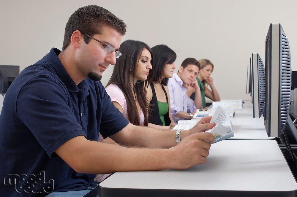 Five students working in computer classroom