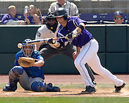 Kansas State's Barrett Rice (R) gets ready to lay down a bunt against Kansas.  The Wildcats held on to beat Kansas 5-4 at Tointon Stadium in Manhattan, Kansas, April 23, 2006.