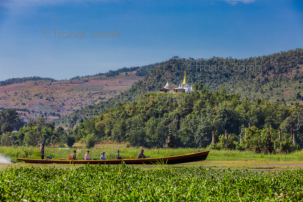 INLE LAKE, MYANMAR - DECEMBER 09, 2016 : tourists on a boat tour on the Inle Lake Shan state in Myanmar (Burma)