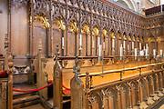 Carved wooden choir stalls inside Norwich Cathedral, Norfolk, England, UK