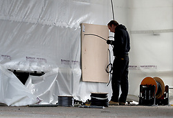A view of a drive-thru COVID-19 screening site being constructed at Estuary View Medical Centre in Whitstable, Kent, as the UK continues in lockdown to help curb the spread of the coronavirus.