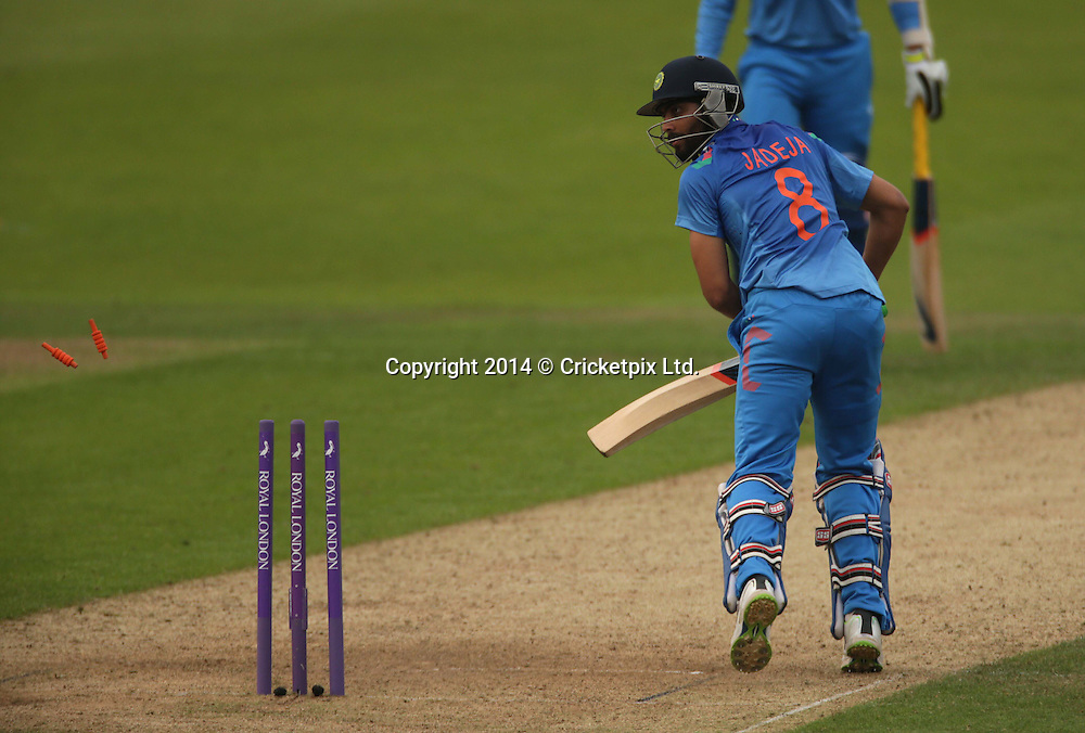 Ravindra Jadeja is bowled by Steven Finn to win the fifth and final Royal London One Day International between England and India at Headingley, Leeds. Photo: Graham Morris/www.cricketpix.com (Tel: +44 (0)20 8969 4192; Email: graham@cricketpix.com) 050914
