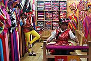 Weaving scarves in old-town Lijiang, Yunnan, China; September, 2013.