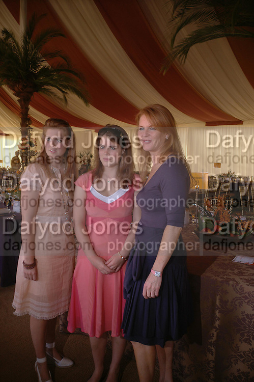 Princess Beatrice, Princess Eugenie and the The Duchess of York. Veuve Clicquot Gold Cup Final at Cowdray Park. Midhurst. 17 July 2005. ONE TIME USE ONLY - DO NOT ARCHIVE  © Copyright Photograph by Dafydd Jones 66 Stockwell Park Rd. London SW9 0DA Tel 020 7733 0108 www.dafjones.com