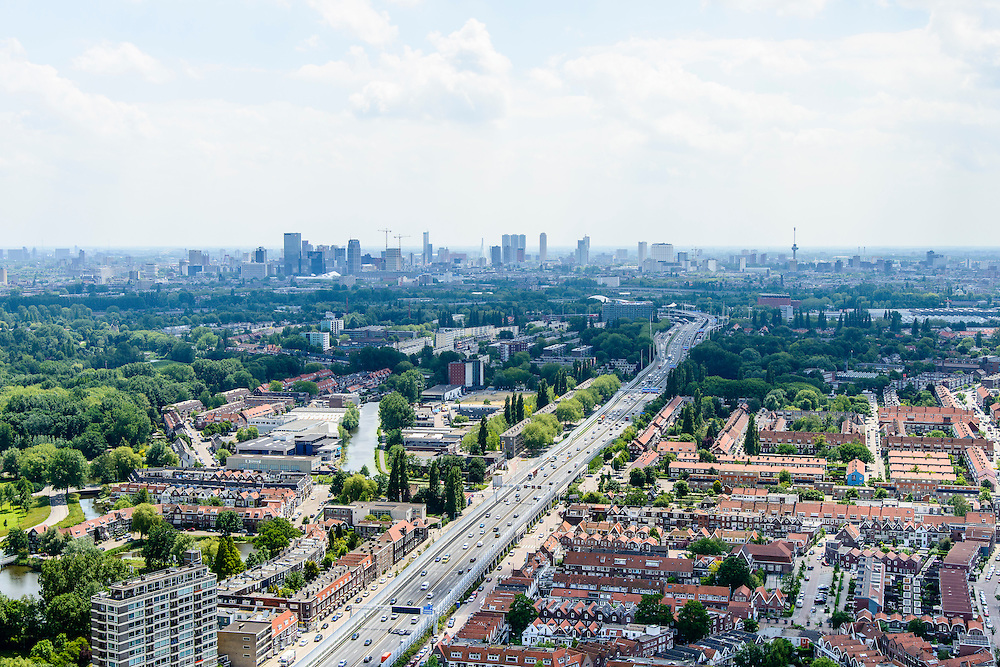 Nederland, Zuid-Holland, Rotterdam, 10-06-2015; stadsdeel Overschie, met 80 kilomterzone en A13 richting Kleinpolderplein. Skyline Rotterdam in de achtergrond.<br /> Overschie  northern Rotterdam , beginnen of Rotterdam ringroad.<br /> <br /> luchtfoto (toeslag op standard tarieven);<br /> aerial photo (additional fee required);<br /> copyright foto/photo Siebe Swart