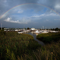 A full arching rainbow that formed over the Monmouth Cove Marine in Port Monmouth NJ after a rain storm that had passed through the area.