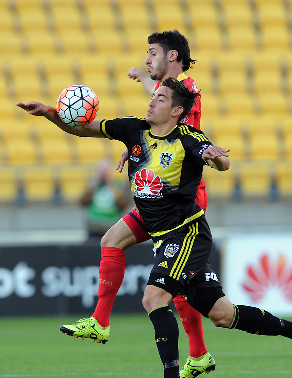 Phoenix's Alex Rodriguez, left and Adelaide United's George Mells contest the ball in the A-League football match at Westpac Stadium, Wellington, New Zealand, Friday, November 13, 2015. Credit:SNPA / Ross Setford