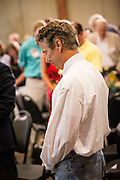 US Senator Rand Paul pauses for prayer before the start of a Republican Party BBQ fundraiser on June 28, 2013 in Columbia, South Carolina. Rand, a Tea Party favorite is planning to run for president in 2016.